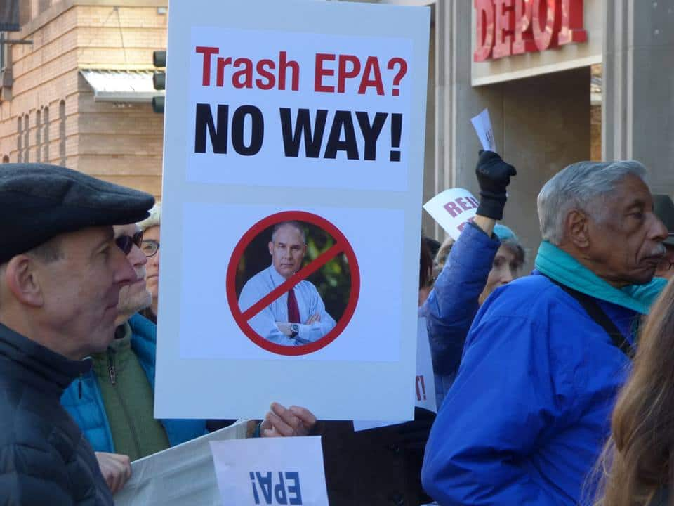 "Protestors and sign with picture of Scott Pruitt saying ""Trash EPA - no way"""