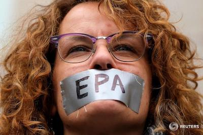 Woman with duct tape over mouth signed EPA