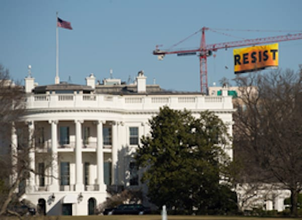 White House with Resist banner