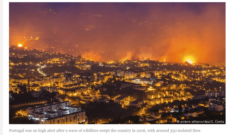 Wildfires surround a Portuguese city in 2016.